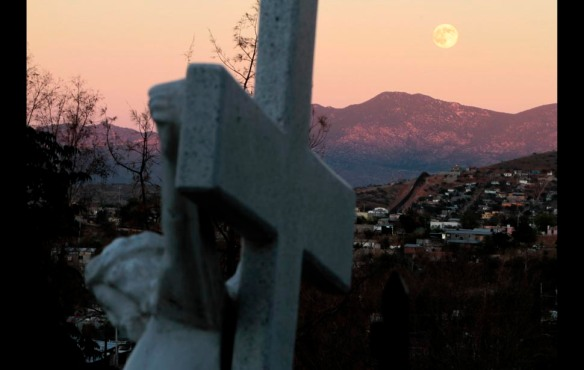 Nogales, Mexico — A full moon rises over the fence that marks the border between Nogales, Ariz., and Nogales, Mexico. For scores of homeless Mexicans recently deported from the U.S., the hillside cemetery is where they'll bed down for the night.
