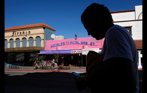 "Nogales, Mexico — Luis Luna walks through the tourist zone of Nogales, Mexico, as he sends a text to his wife in Pasco, Wash. Minutes before, he had failed to jump a northbound freight train, so he tapped out a message to her: ""Maybe God doesn't want me to leave today.""11 / 12 HIDE CAPTIONS SHOW THUMBNAILS LEAVE COMMENT PHOTOGRAPH BY: Don Bartletti / Los Angeles Times"
