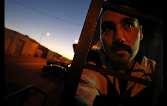 Los Angeles — At dawn, Luis Luna waits outside the warehouse where he works. His minimum wage job barely pays his rent, but it provides some stability in a country where he is locked out of most job opportunities.