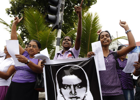 Demonstrators hold up an image of Rizana Nafeek as they shout slogans during a protest against her execution, in Colombo