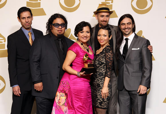 "Musical group Quetzal poses backstage with its award for Latin rock, urban or alternative album for ""Imaginaries"" at the 55th Grammy Awards. (Matt Sayles / Invision / Associated Press)"