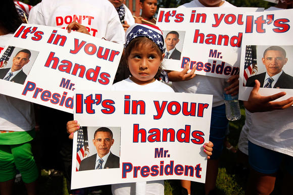 "According to the Applied Research Center's report ""Shattered Families,"" at least 5,000 children of immigrants live in U.S. foster care because their parents were detained or deported. Above: Demonstrators describing themselves as ""Obama Orphans,"" or children whose parents have been deported, are seen outside the White House in 2010. (Chip Somodevilla / Getty Images / February 8, 2013)"