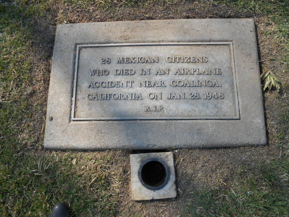 A simple, tarnished plaque marks the grave of 28 'deportees' who died in a plane crash near Coalinga in 1948