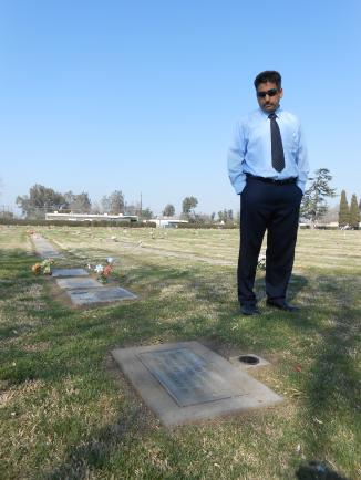 Carlos Rascon, director of cemeteries for the Roman Catholic Diocese of Fresno walks past the grave of the 28 'deportees'
