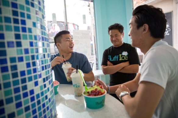 "Monica Almeida/The New York Times From left, David Fung, Matthew Hui and Andrew Fung at Mr. Hui's Asian fusion shaved ice shop. ""This culture doesn't exist everywhere,"" David Fung said."