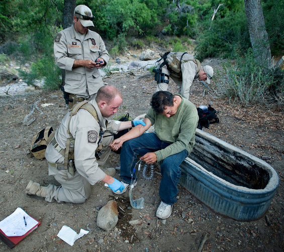 Border Patrol agents help a Mexican in this PBS program