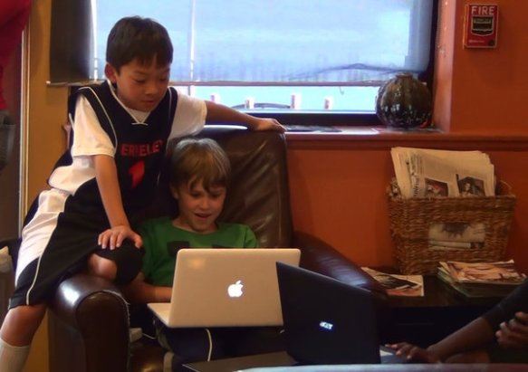 Kyle Kuwahara, left, and Jude Kratzer use the video game Minecraft to stay in touch with classmate Rodrigo Guzman, 10, who was deported along with his family to Mexico. (Craig Kuwahara)